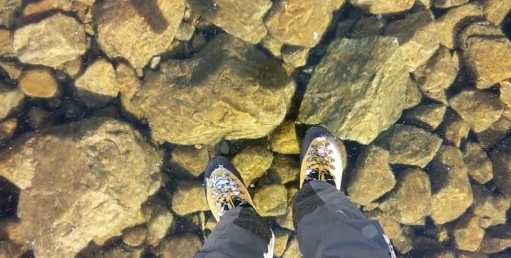 Hikers-find-a-frozen-lake-so-clear-it-looks-like-you're-walking-on-air-990x500